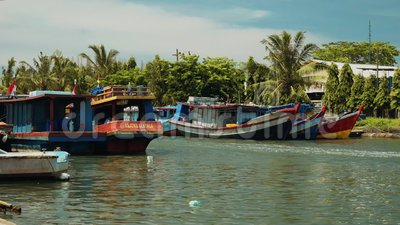 Fishing boats sailing in river in Cilacap, Java, Indonesia. On sunny summer day stock video footage