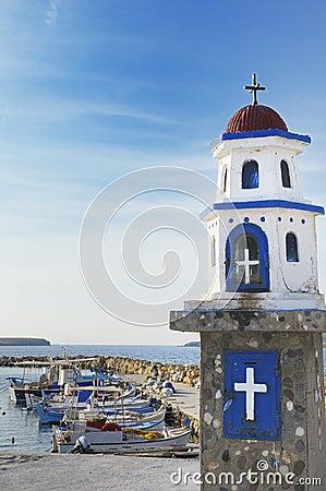 Fishing boats and shrine, Greece.