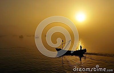 Fishing boats, sunset