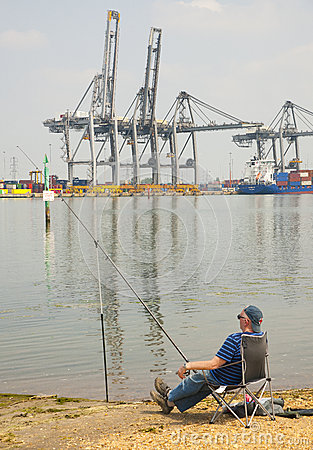 Fishing by the container port Editorial Image