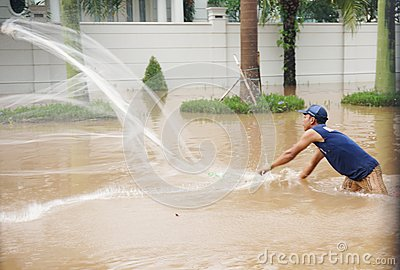Fishing in the flood Editorial Stock Image