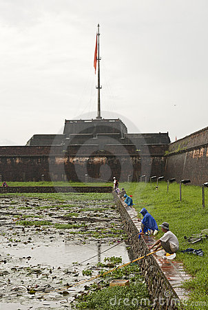 Fishing in front of the Citadel in Hue Editorial Stock Image