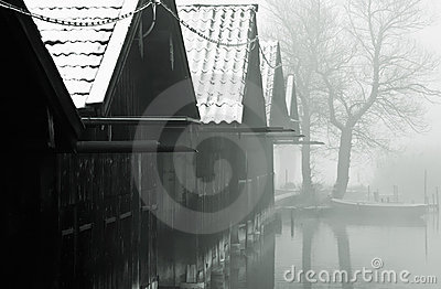 Fishing huts and misty lake