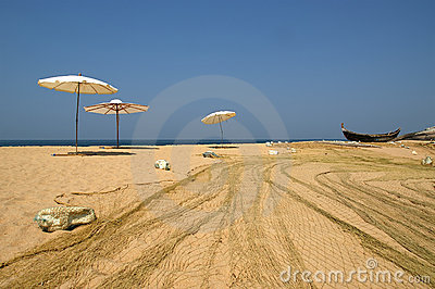 Fishing net and umbrellas Sol on the beach