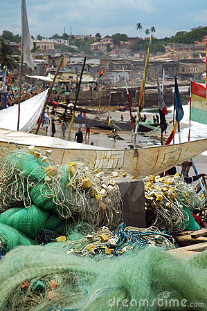Fishing nets and boats on Cape Coast foreshore