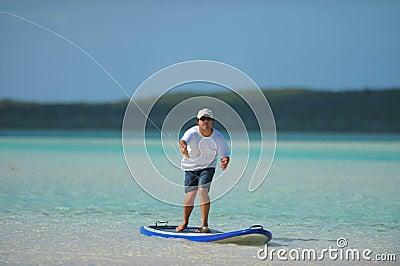Fishing and paddleboarding