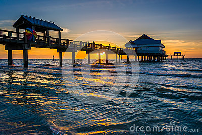 Fishing pier in the gulf of mexico at sunset clearwater for Fishing clearwater beach fl