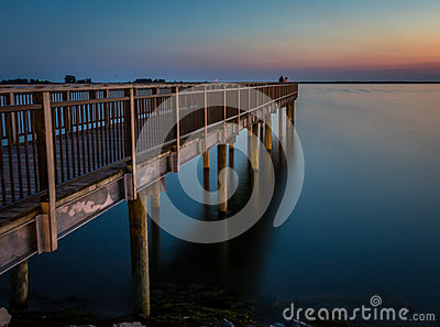 Fishing pier over lake erie at sunset stock photo image for Lake erie pier fishing