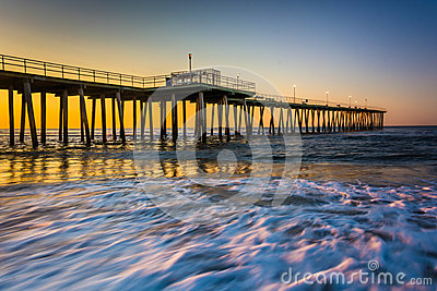 Fishing pier and waves on the atlantic ocean at sunrise in for Atlantic city fishing pier