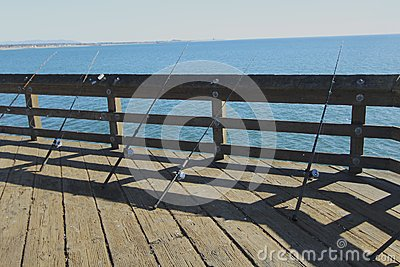 Fishing poles on the pier