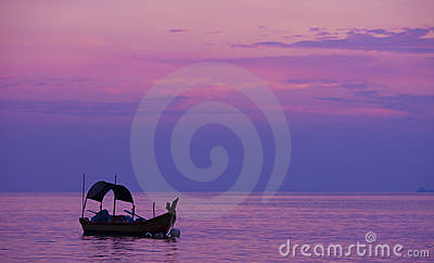 Fishing on the purplr dawn sea