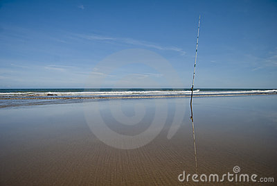 Fishing rod at the sand of the beach