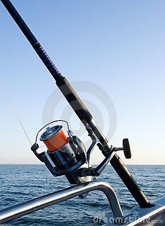 Fishing rod reel at sea.