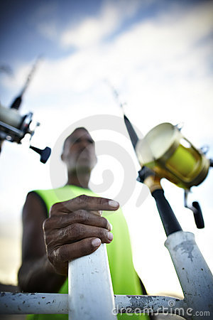 Free Fishing Rods And A Fisherman Royalty Free Stock Photos - 14083208