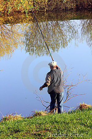 Fishing senior on lake