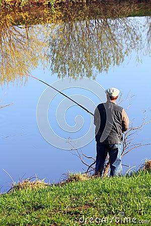 Fishing senior on lake