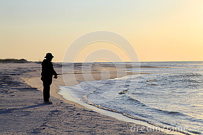 Fishing from the Shore at Sunrise