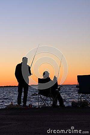 Free Fishing. Sunset Silhouettes Royalty Free Stock Photo - 20274675