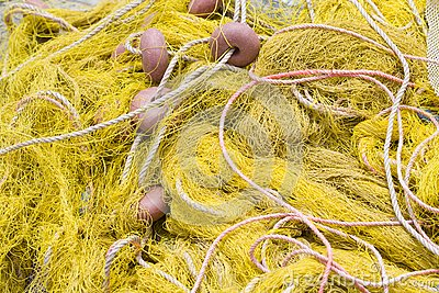 Fishing tackle: net, float, rope close-up