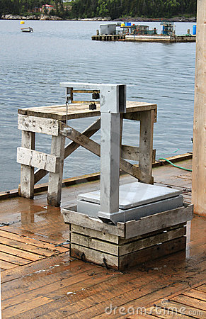 Fishing weighing scale on pier