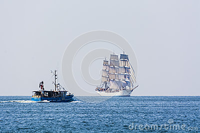 Fishingboat meets fullrigger Christian Radich Editorial Stock Photo