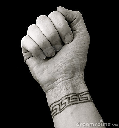 FIST WITH WRIST TATTOO IN GREEK KEY PATTERN OVER BLACK BACKGROUND
