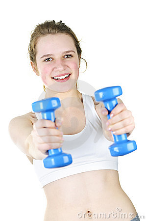 Fit active girl exercising with weights
