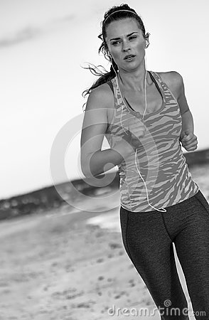 Free Fit Active Woman On Beach In Evening Jogging Royalty Free Stock Image - 115508666