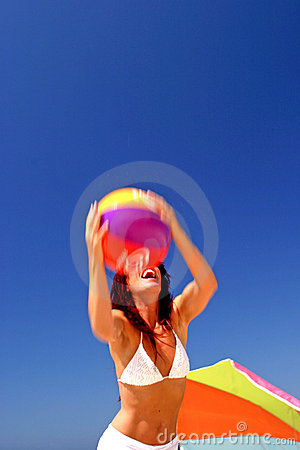 Free Fit And Healthy Woman Catching Beach Ball On Sunny Beach In Spain. Royalty Free Stock Image - 124736