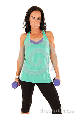 Fit attractive brunette woman holding barbells