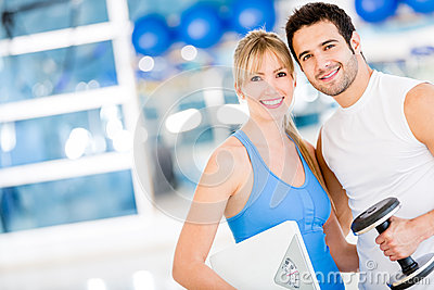 Fit couple at the gym