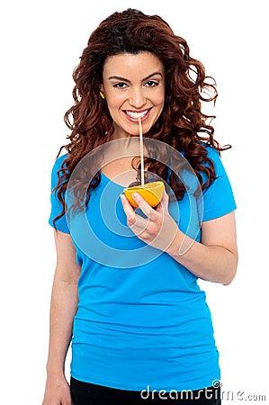 Fit girl drinking fresh orange juice