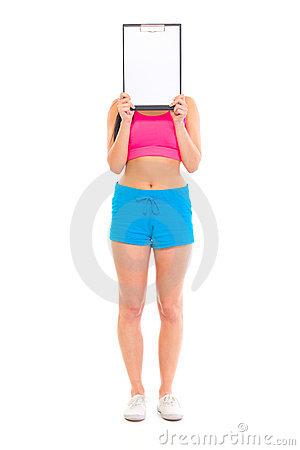 Fit girl holding blank clipboard in front of face