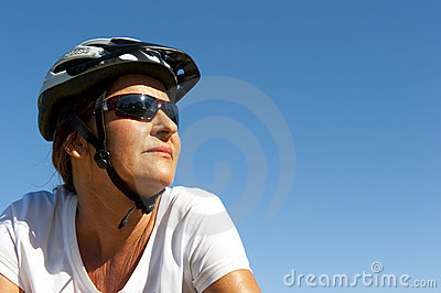 Fit and healthy woman on a bike ride