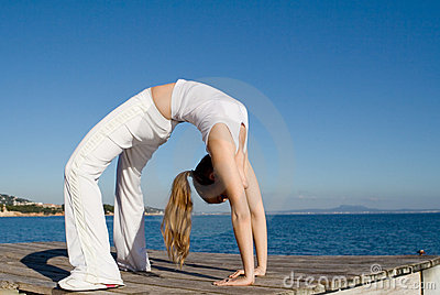 Fit healthy woman doing back bend