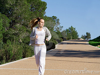 Fit healthy woman jogging