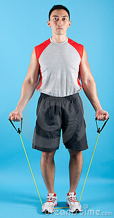 Fit man with exercise stretch band