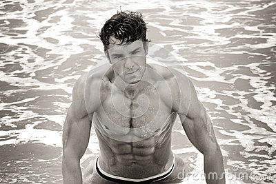 Fit man in water