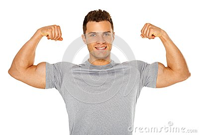 Fit and muscular man flexing his biceps on white