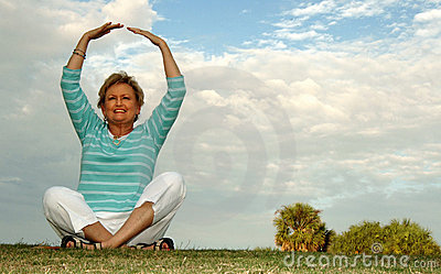 Fit senior woman meditation/praise