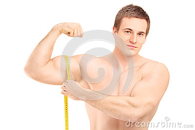 Fit shirtless guy measuring his muscle