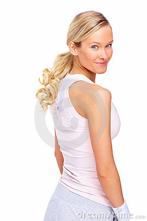 Fit sporty young woman looking back over shoulder
