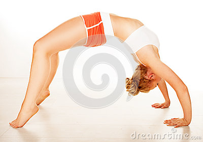 Fit supple woman arching over her back