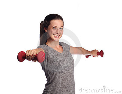 Fit teenager lifting weights