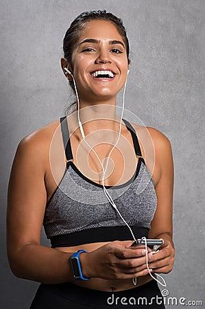 Free Fit Woman Enjoying Music Royalty Free Stock Photo - 92107725
