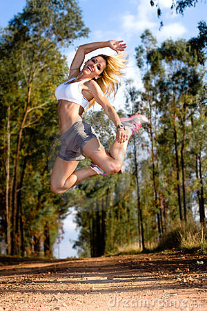 Fit woman jumping high