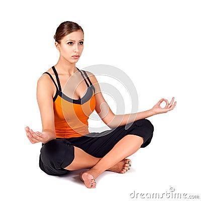 Fit Woman Practicing Sukhasana Yoga Pose