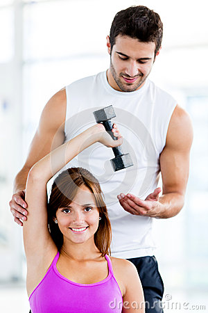 Fit woman with trainer