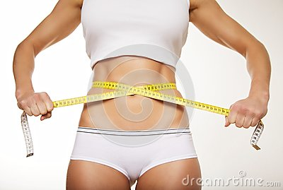 Fit woman in underwear with measure tape