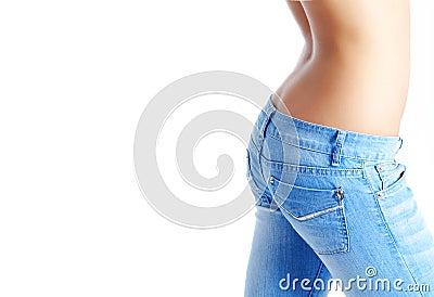 Fit woman wearing blue  jeans